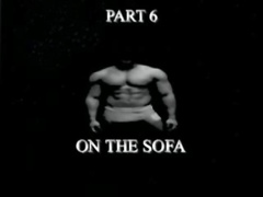 Ont the sofa at the end