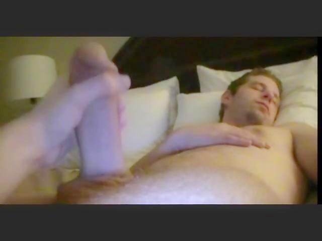 Handjob to Whitezilla in bed